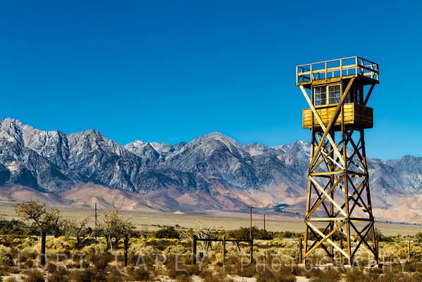 Guard tower at Manzanar National Historic Site in Independence, California. There were originally 8 guard towers around the perimeter of the Manzanar War Relocation Center, staffed by Military Police with submachine guns. The National Park Service rebuilt this one in 2005.
