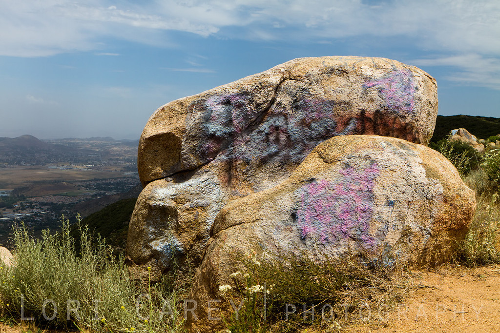 Graffiti on rocks at hang gliding/parasailing launch zone off South Main Divide/Killen Truck Trail in Cleveland National Forest, California, USA