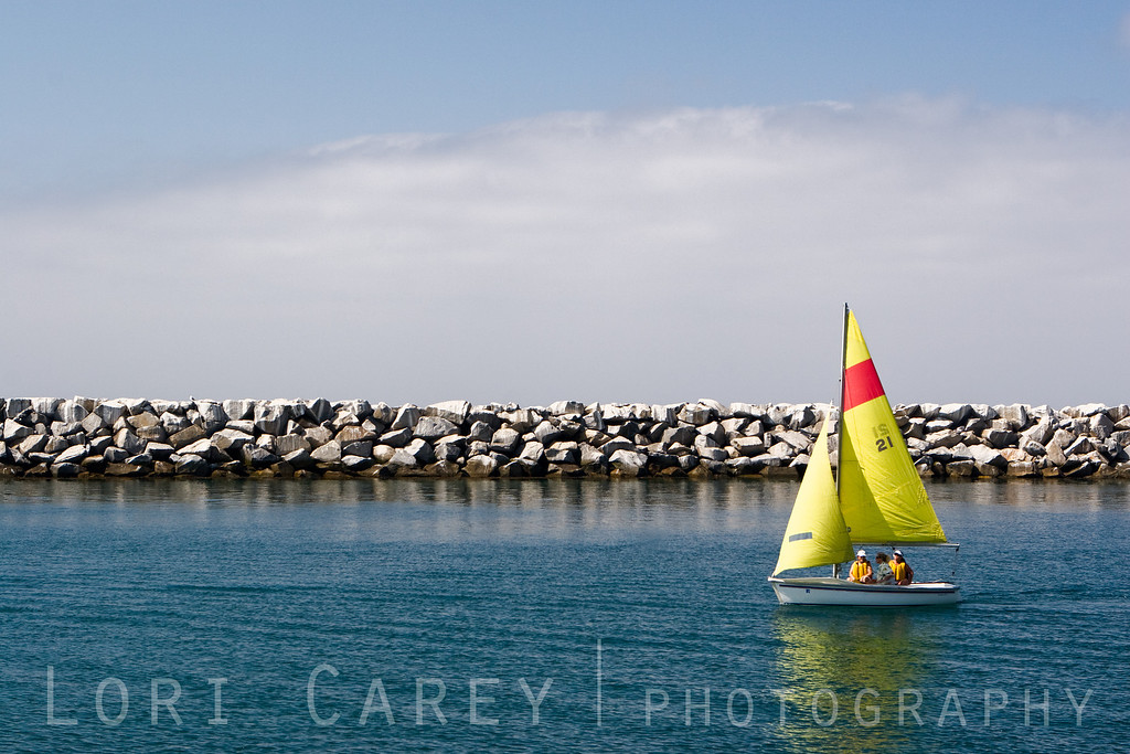 "Three women in a small sailboat sail through Dana Point inlet while participating in a morning sailing lesson. Thick marine layer clouds in the background. <br><br> <a href='http://www.licensestream.com/LicenseStream/client/contentDisplay.aspx?cid=12178&fid=12891&l=r'><font color=""red"">License this Image</font></a>"