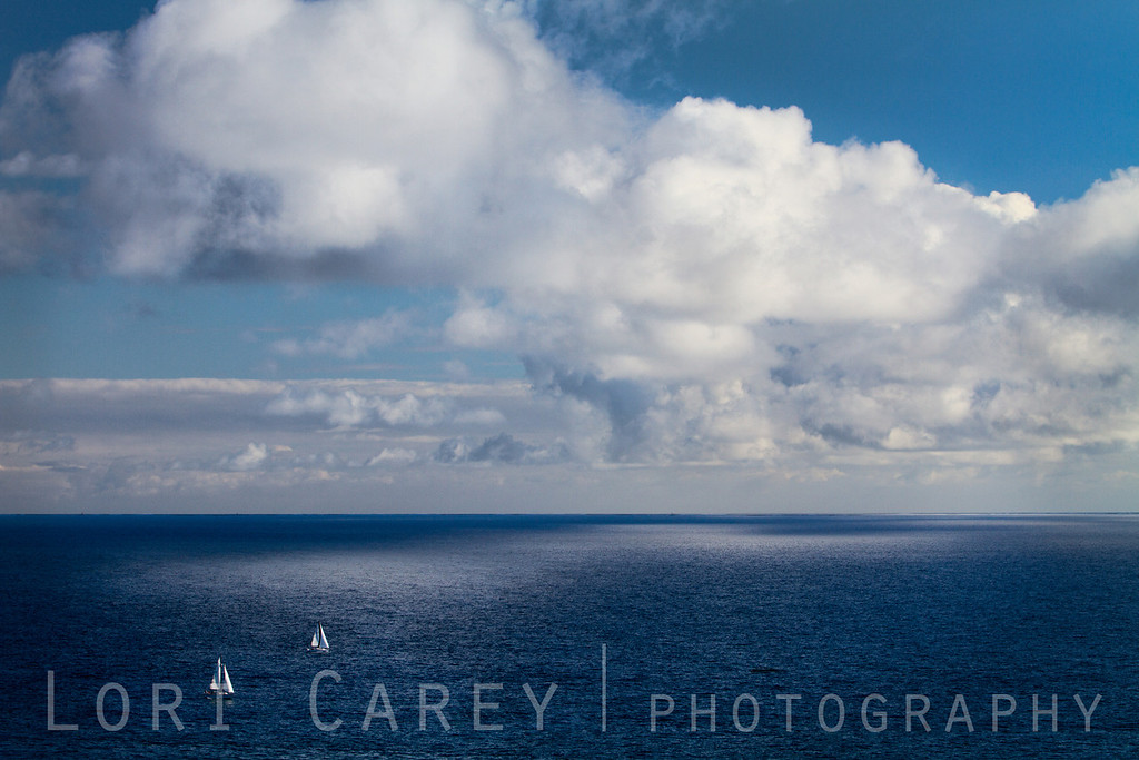 Sailing on Clouds II. Two sailboats and clouds with reflection in Dana Point, California