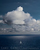 Sailing on Clouds. Sailboat and clouds with reflection in Dana Point, California