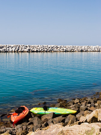 Two kayaks on the shore of the Dana Point inlet