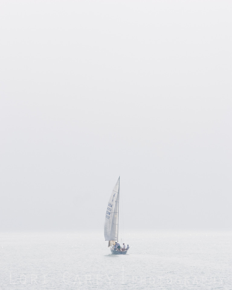 Sailboat in fog, Dana Point, California