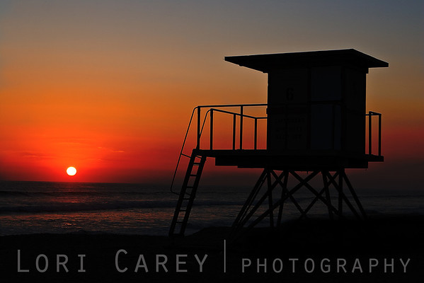 Lifeguard Tower silhouetted at sunset, San Onofre State Beach, California
