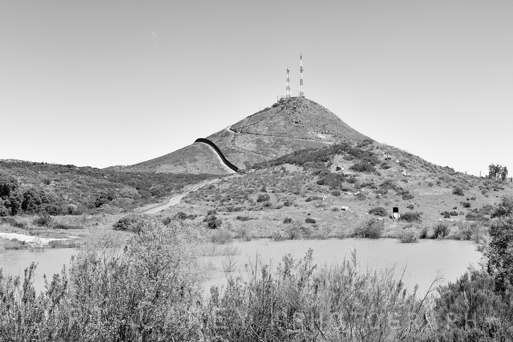 Communications towers and fence, US-Mexico border