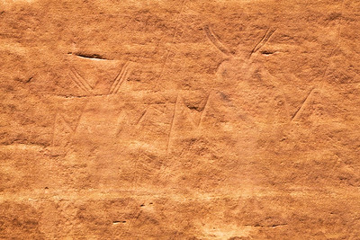 Anthropomorphic petroglyphs with rake-like objects, Fremont, Molen Reef, Utah