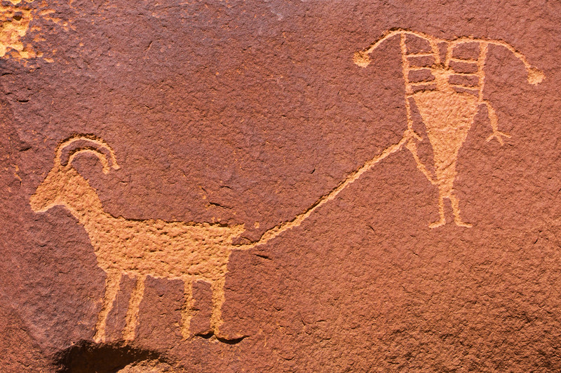 Anthropomophic figure connected to bighorn sheep petroglyphs, Fremont, Nine Mile Canyon, Utah