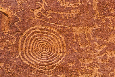 Basketmaker mountain lion with spiral and other petroglyphs, Utah