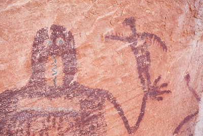 Anthropomorph with green eyes and tongue, Barrier Canyon Style, Desert Archaic, Utah
