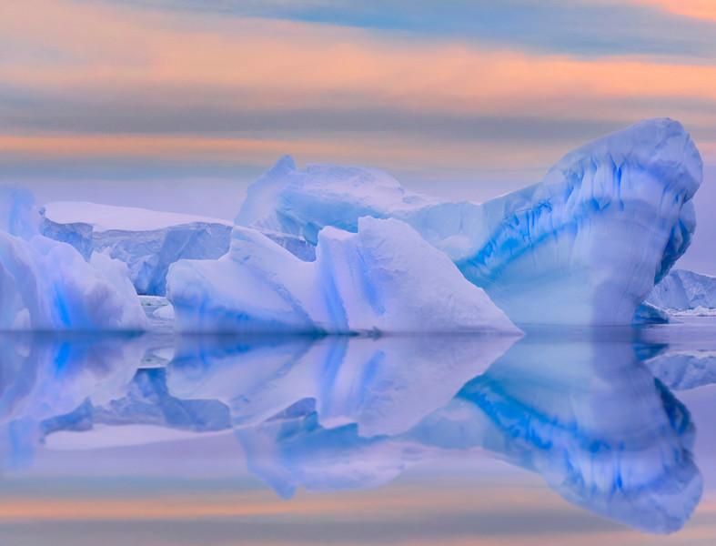 Split Sunset Iceberg Reflections -  Cuverville Island, Antarctica