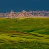 Light Shining On Badlands In Stormy Weather - Badlands National Park, South Dakota