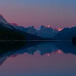 The calm waters of Maligne Lake reflect the grandeur peaks of Jasper National Park