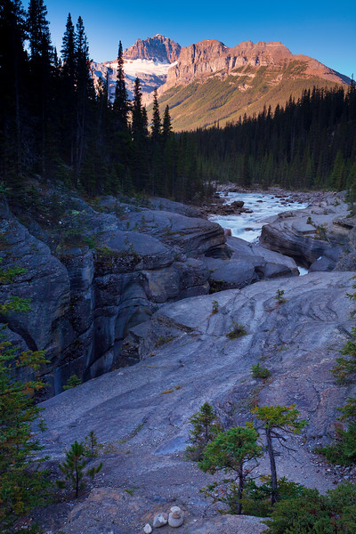 The rushing water complements the landscape of the Mistaya Canyon in Banff National Park