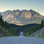 The Maligne Lake Road surrounded by high peaks leads to the stunning Maligne Lake in Jasper National Park