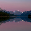 The calm waters of Maligne Lake reflect the grandeur peaks of Jasper National Park