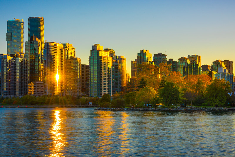 Sunburst Mirror Reflections Of Vancouvers Skyline - Stanley Park Seawall, Vancouver, BC, Canada
