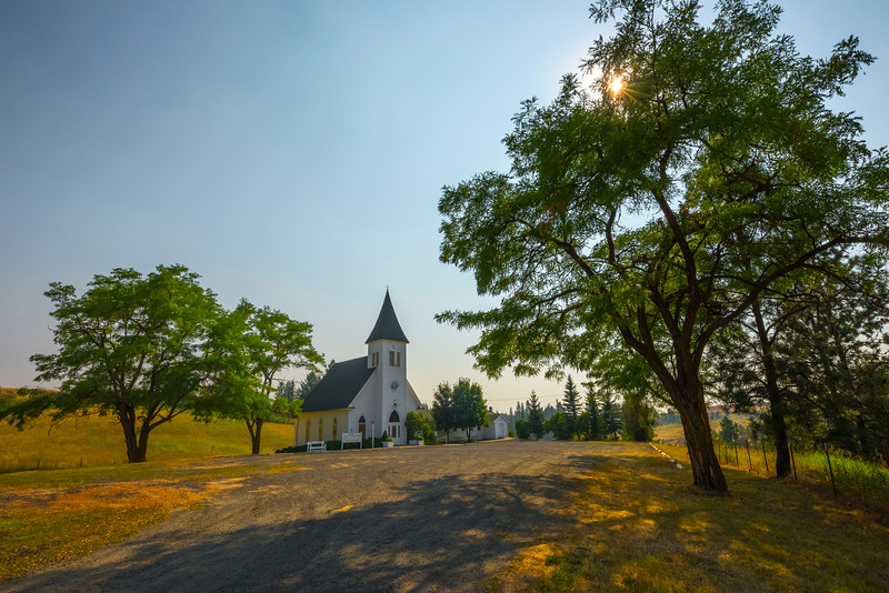Sun Shining Through Trees At Lone Church - Lutheran Church, Fort Spokane, Central WA
