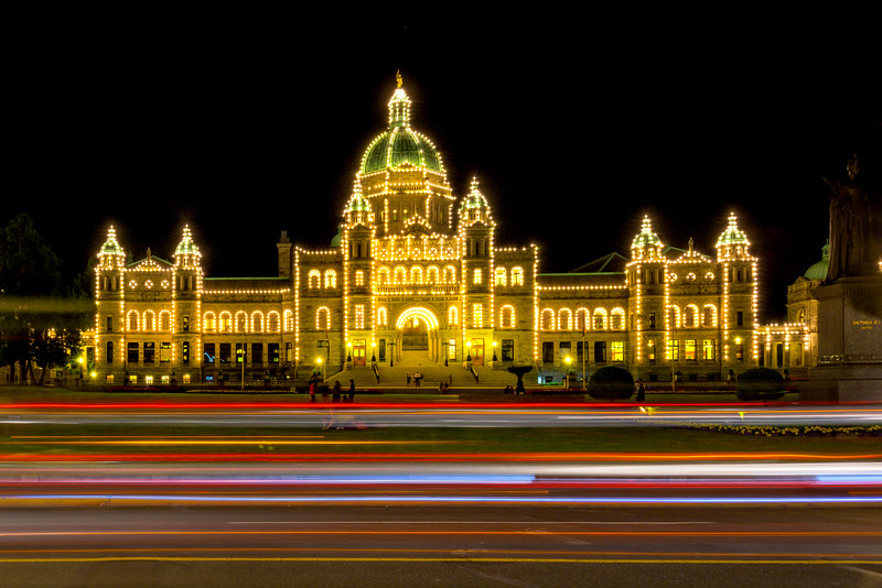 Parliament Buildings And Passing Cars - Victoria Harbor, Vancouver Island, BC, Canada