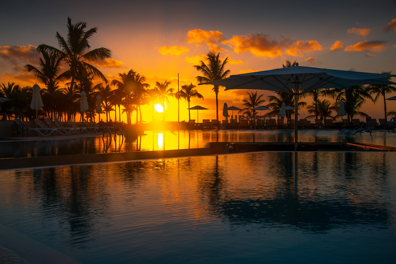 Sunset Reflections Off The Pool