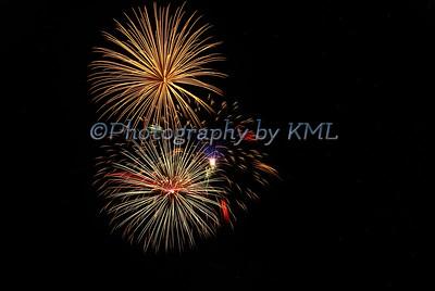 bright fireworks against a dark night sky