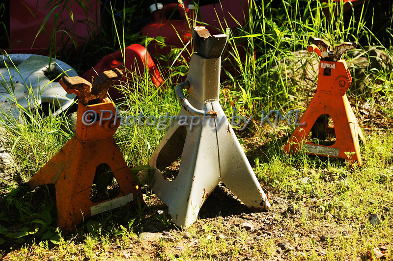 several jack stands in the grass