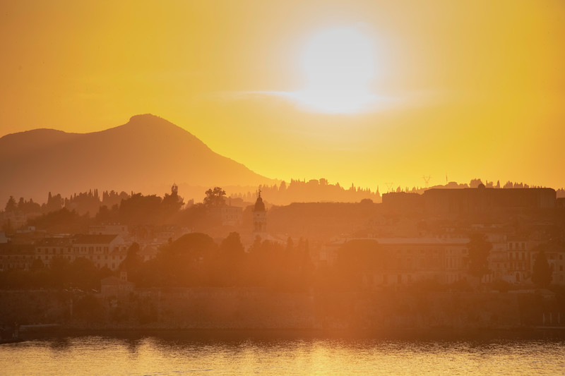 A Sunset Glow Beaming Down On Old Corfu Corfu, Greece