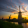 Under The Sunset Sky And Windmills