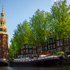 The Clock Tower In Center Of Amsterdam