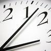 Closeup of round black and white clock