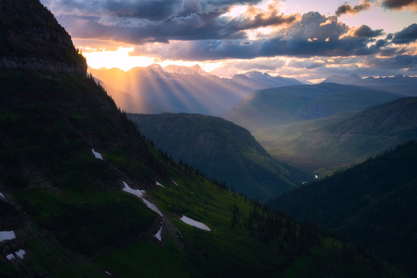 Sunburst Rays Illuminate Rolling Hills - Going To The Sun Road, Glacier National Park, Montana