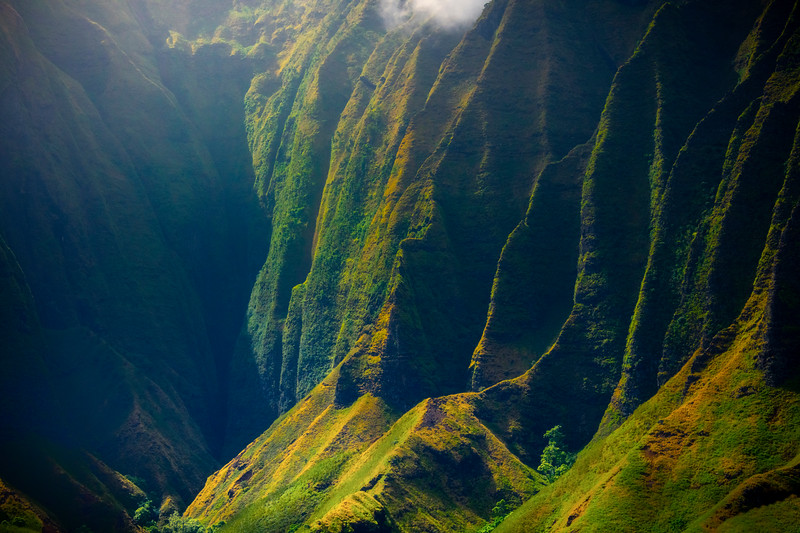 Scattered Light From Above Shines in Caverns - Na Pali Coastline, Kauai, Hawaii