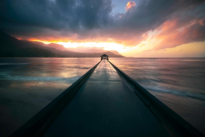 Walking The Hanalei Pier At Sunset