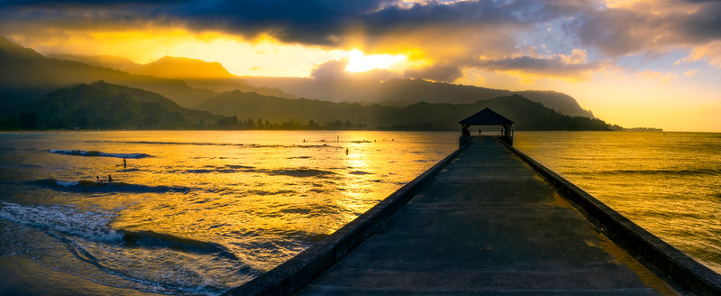 Pano Of Hanalei Pier And People Surfing
