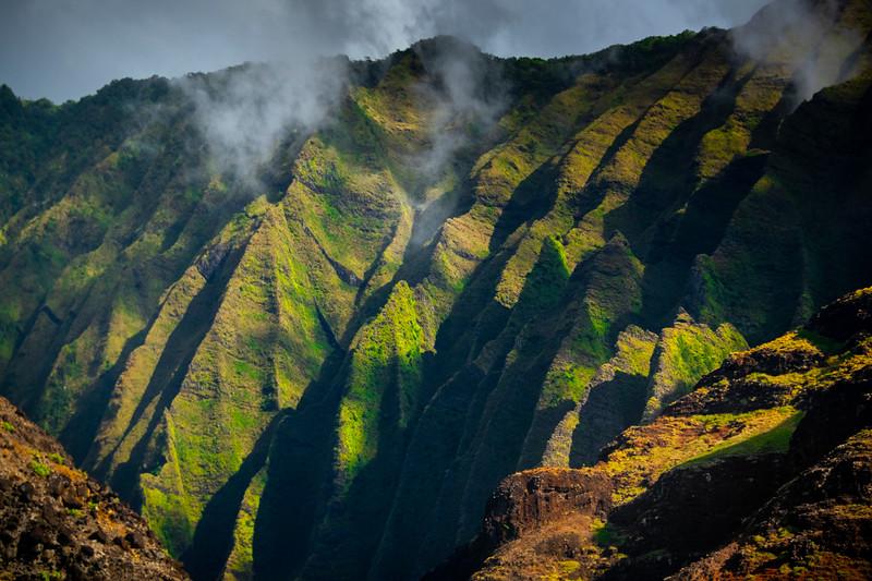 Dappled Light Across The Rock Face Of Na Pali - Na Pali Coastline, Kauai, Hawaii