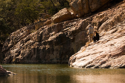 Rock Fishing  Fishing off of the pink granite rocks of Inks Lake State park.  Image # 80066_1102