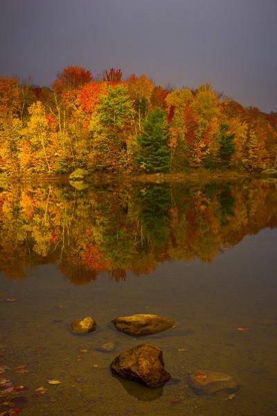 A Glimmer Of Light Shines On Shoreline Color
