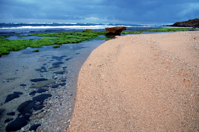 North Shore - Sand Line near Ho'okipa at low tide at sunset with stormy skies