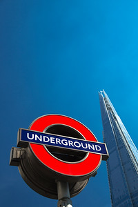 Iconic London Underground Sign in Front of The Shard