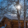 Sunburst Over Snow Cabin -Chena Hot Springs Resort, Fairbanks, Alaska