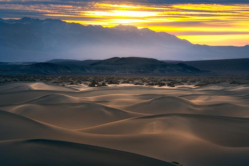 Sun Begins To Peak Through Clouds Onto Mesquite Dunes - Death Valley National Park, California