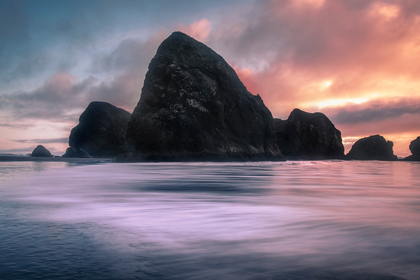 Sunset Clouds Moving Over Sea Stacks