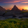 Twilight Reds Settle Over The Pyramids - Badlands National Park, South Dakota