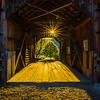 Sunstar Shining Through Covered Bridge