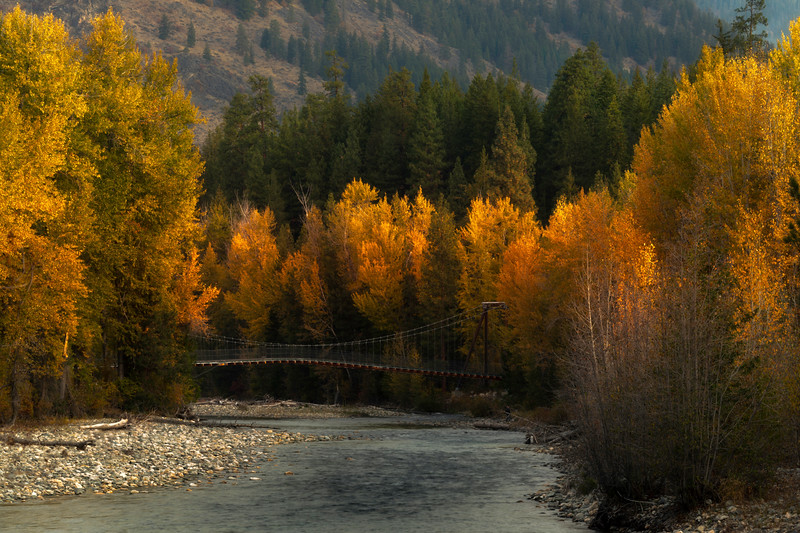 Looking Down The River Channel At The Tawlks-Fosteer Suspension Bridge - Methow Valley, Washington State