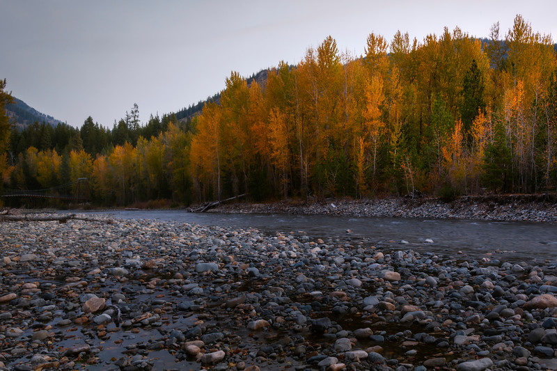 Fall Colors Surround The Tawlks-Foster Suspension Bridge Along The Methow River - Methow Valley, Washington State