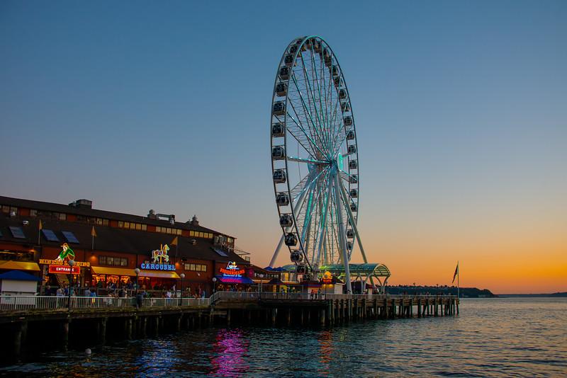 Sunset Light Shines On The Seattle Waterfront - Seattle, WA