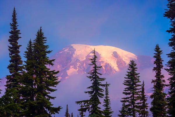 Top Of Mt Rainier In Mist At Sunrise