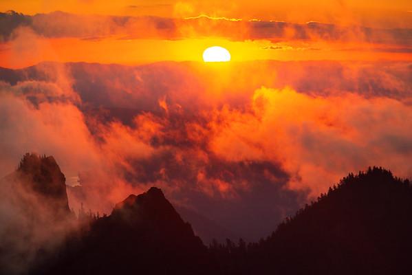 High Above It All As Sun Dips Below Clouds - Mount Rainier National Park, WA