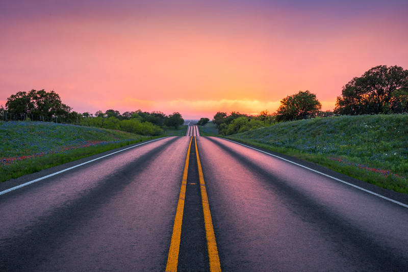Driving The Highway Into The Sunset