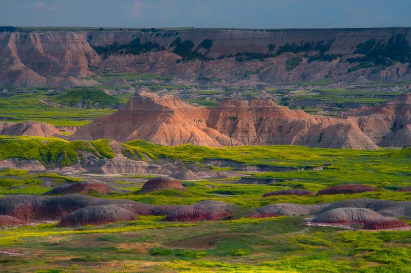 Red Stepping Rocks In Front Of Badlands - Badlands National Park, South Dakota